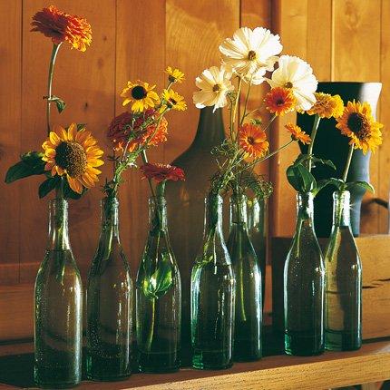 botellas de vídreo como jarrones